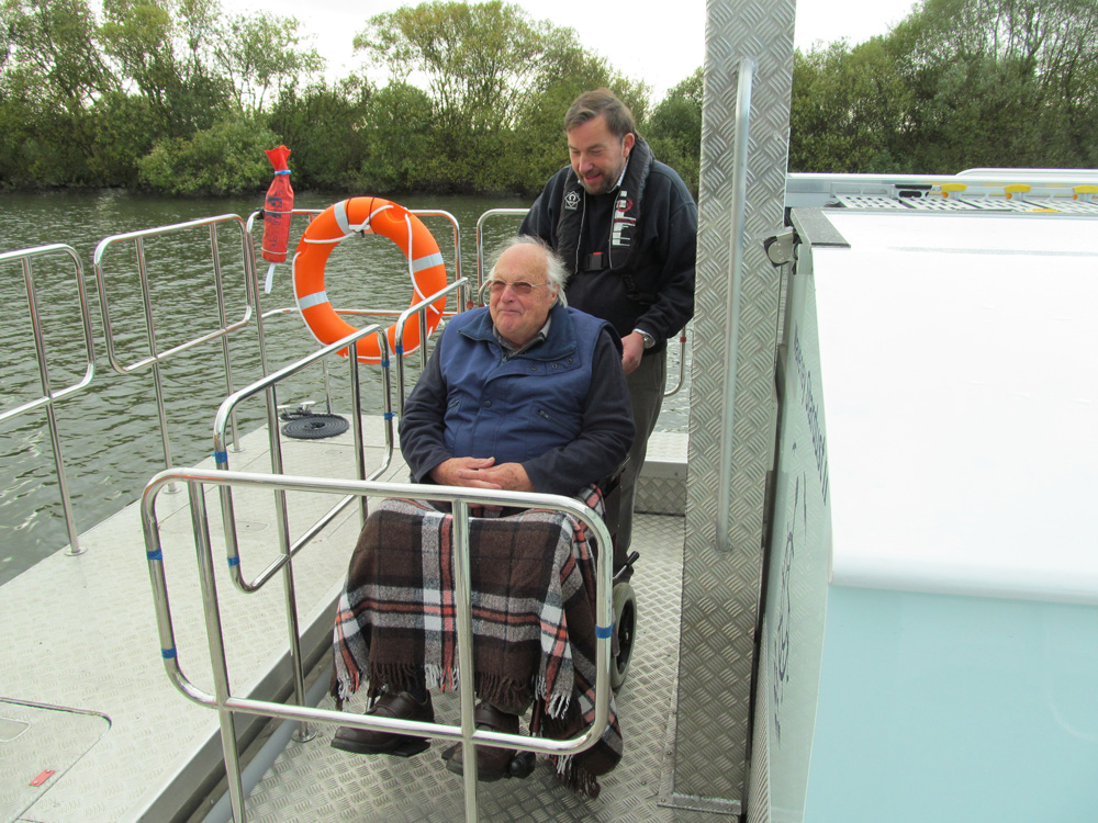 Easy wheelchair access using platform hoist
